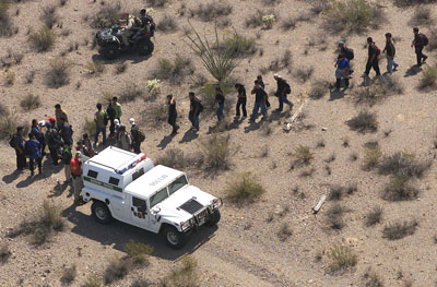 Three Points, Arizona, July 2004. Federal agents round up a group of suspected undocumented immigrants tracked by a Black Hawk helicopter.