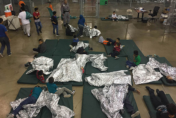 children separated at border with foil blankets