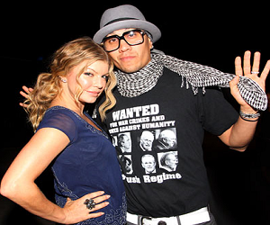 "Taboo from the Black Eyed Peas wearing the ""Wanted for War Crimes & Crimes Against Humanity"" anti-Bush Shirt"