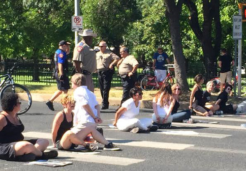 Abortion Rights Freedom Riders get arrested outside Gov. Rick Perry's mansion. August 13, 2014